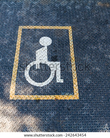 Handicapped sign on Rusty Surface of  old Checkered Plate - stock photo