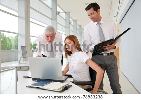Handicapped woman attending a meeting in office - stock photo