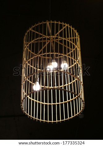 Handicraft electric lamp on ceiling - stock photo