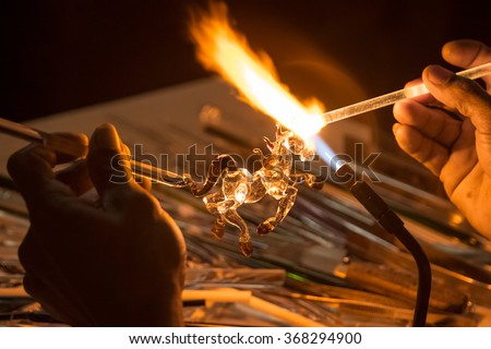 Handicraft from glass blowing horse shape - stock photo