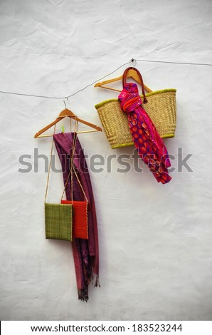Handicraft hanging in a string over a white wall - stock photo