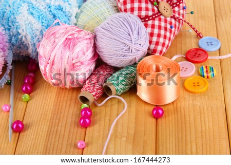 Handicraft supplies on wooden table close-up