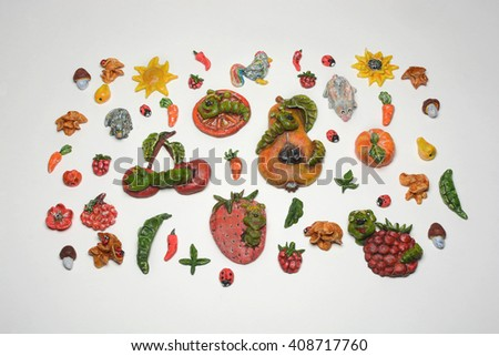 handicrafts depicting summer pests , fruits vegetables on a white background - stock photo