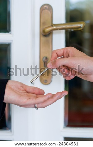 handing over the house key - stock photo