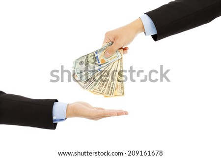Handing Over us dollar Cash to Other Hand Isolated on a White Background. - stock photo