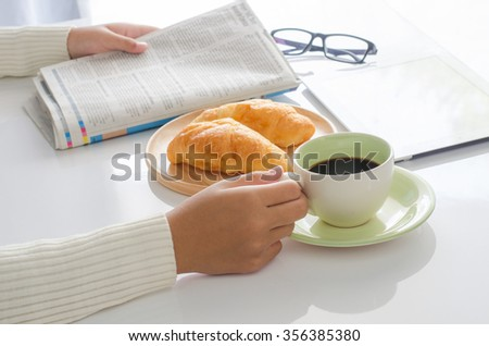 Handle  Coffee and reading  newspapers. - stock photo