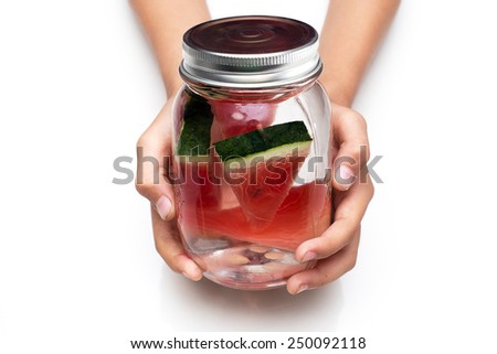 Handle delicious drink a glass of fresh water melon . -  infused water - stock photo