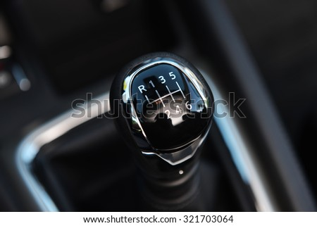 handle for switching speeds in modern car - stock photo
