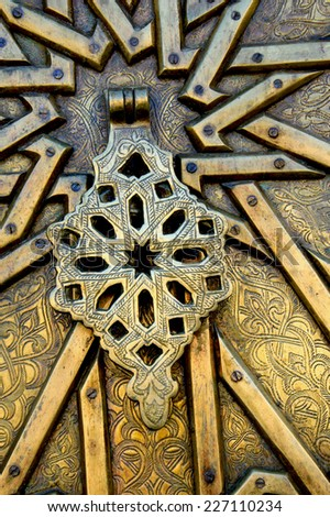 Handle on golden ornate door in Old Jaffa. Architectural detail. (Tel Aviv-Jaffa, Israel) - stock photo