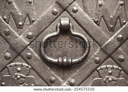 handle on metal solid doors - stock photo