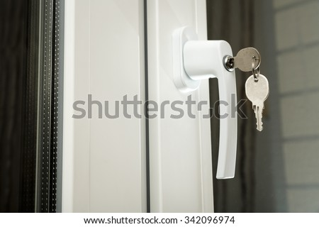 Handle plastic windows with keys in closeup - stock photo