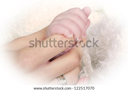 handle the baby in the hands of the mother