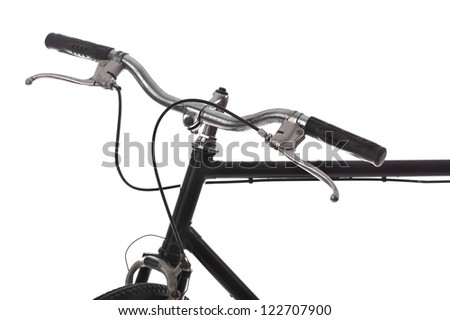 Handlebar of a bicycle isolated on white - stock photo