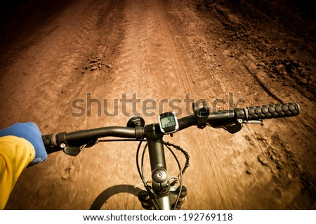 handlebars and driving on rough terrain - stock photo