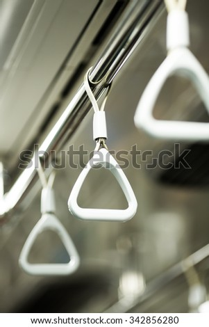 Handles for standing passenger in train. - stock photo