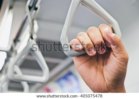Handles in Subway Trains - stock photo