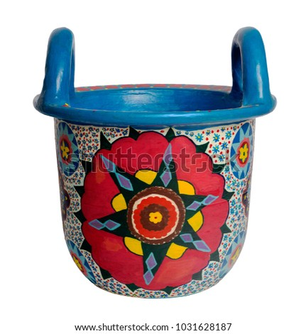 Handmade artistic pained colorful decorated pottery basket with two handles on white background including clipping path