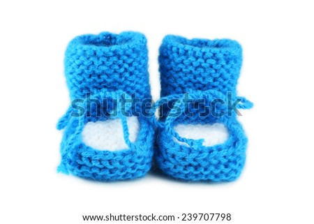 Handmade baby booties isolated on a white - stock photo