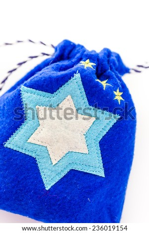 Handmade bag with Star of David on a white background.