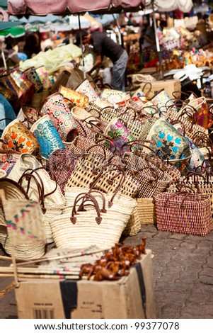 Handmade bags in Moroccan traditional market in center of Souks - stock photo