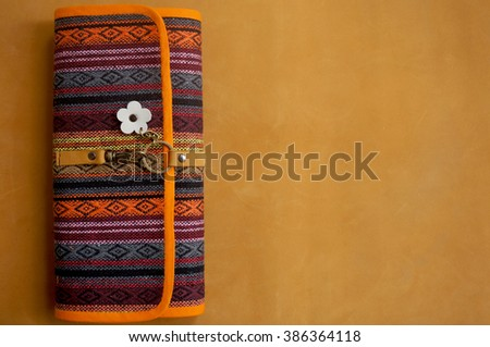 Handmade bags on the leather brown color wallpaper - stock photo