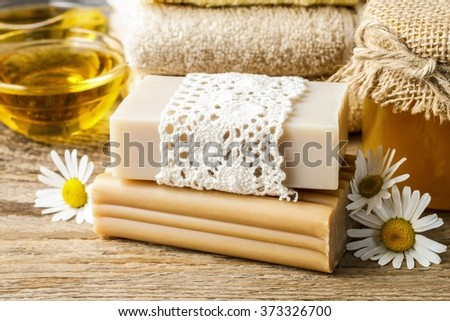 Handmade bars of soap and chamomile flowers - stock photo