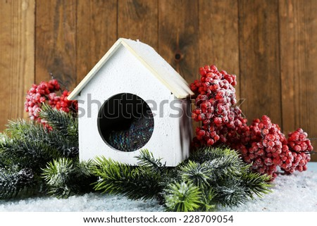 Handmade birdhouse in winter - stock photo