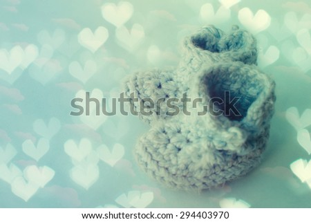 Handmade blue baby booties - stock photo