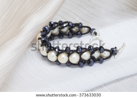 Handmade bracelet with large pearls - stock photo