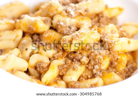 handmade cavatelli pasta with a rich meat tomato sauce