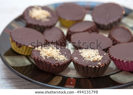 Handmade chocolate sweets sprinkled with walnut powder