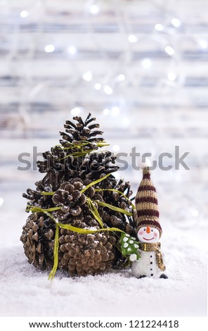 Handmade Christmas cone tree with snowman - stock photo