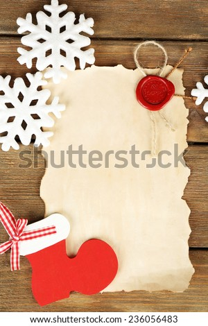 Handmade Christmas decorations  and old paper sheet on wooden background