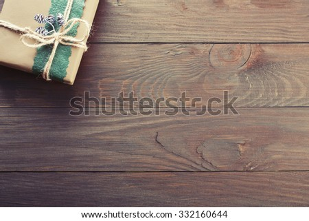 Handmade christmas gift box on wooden table with copy space