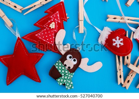 handmade christmas toys with clothespins on blue background