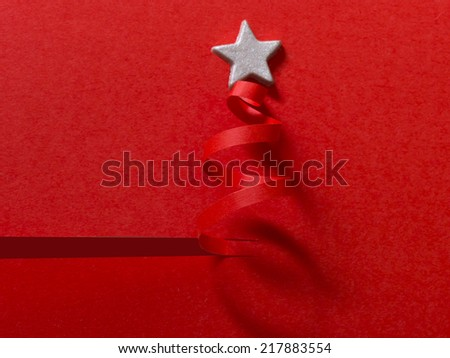 handmade Christmas tree cut out from paper, simple and effective solution - stock photo