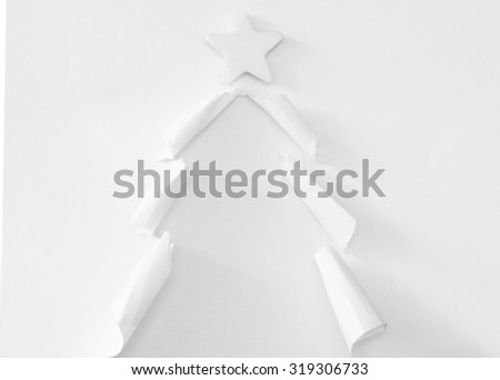 handmade Christmas tree cut out from white paper