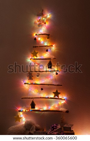 Handmade Christmas tree hanging on the wall in the living room - stock photo