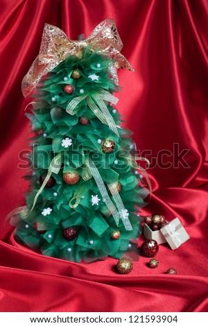 Handmade Christmas Tree on Red Drapery - stock photo