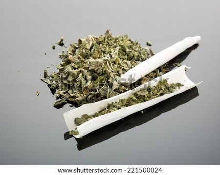 Handmade cigarette on gray background - stock photo
