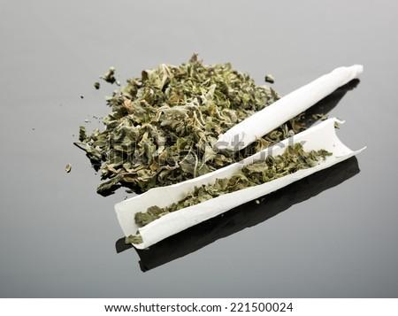 Handmade cigarette on gray background - stock photo