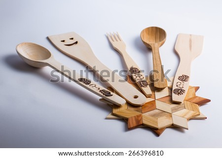 Handmade collection of wooden kitchen utensils. - stock photo
