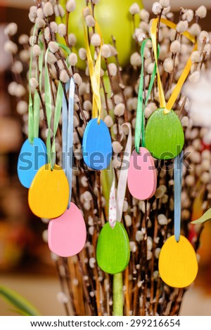 handmade colorful Easter wooden eggs on tree branches - stock photo