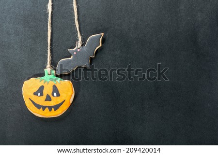 handmade cookies for Halloween on a black background - stock photo