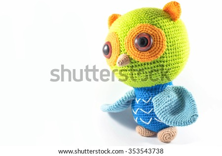 handmade crochet doll,owl on isolate bacground