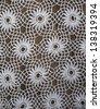 Handmade crochet tablecloth pattern - stock photo