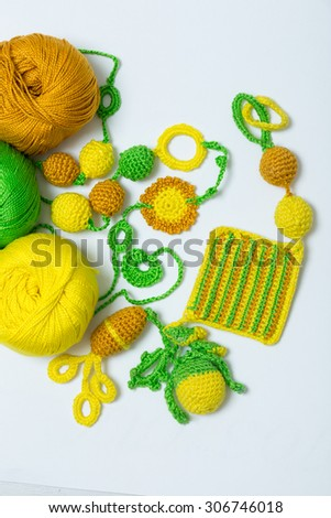 Handmade crocheted pot with wool and crocheting hook - stock photo