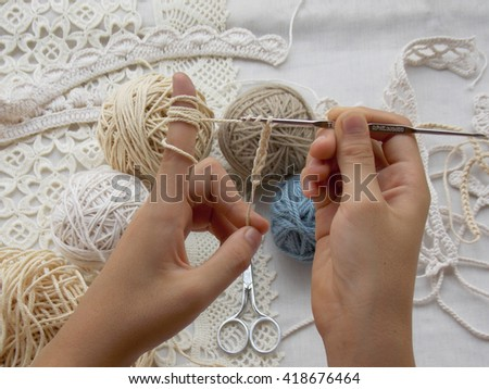 Handmade crocheted with wool and crochet hook in hand - stock photo