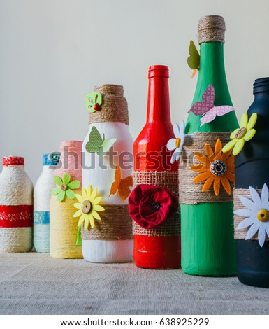 decorated glass bottles. handmade decorated color glass bottles with string Handmade Decorated Color Glass Bottles String Stock Photo  Royalty