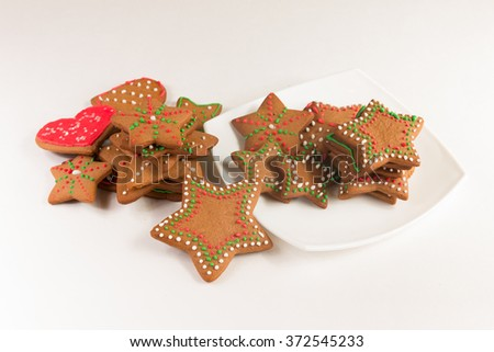 Handmade decorated ginger cookies on the white background